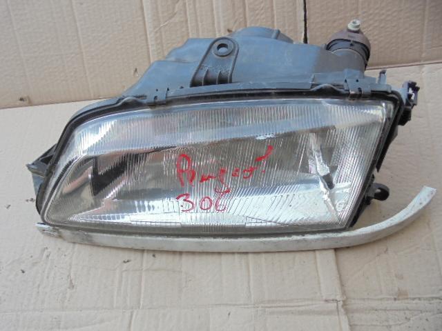 Far Peugeot 306 partea stanga cod 0291091