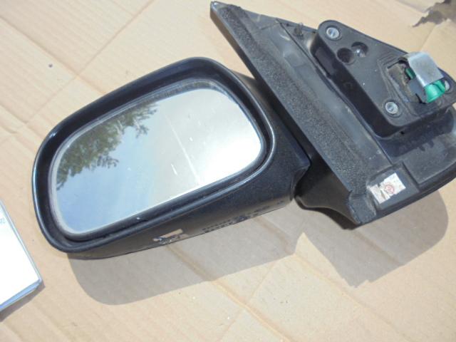 Oglinda stanga Suzuki Ignis 2002 cod 2139-040LH